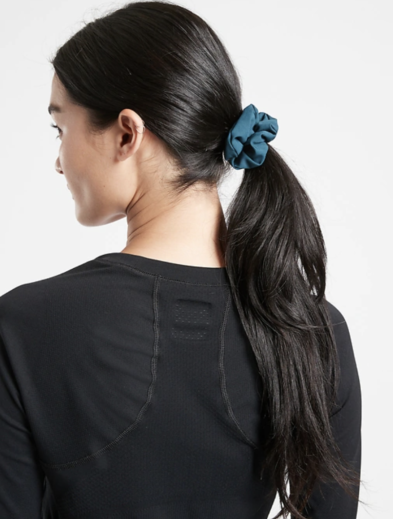 Model wears scrunchie in Oceanic Teal