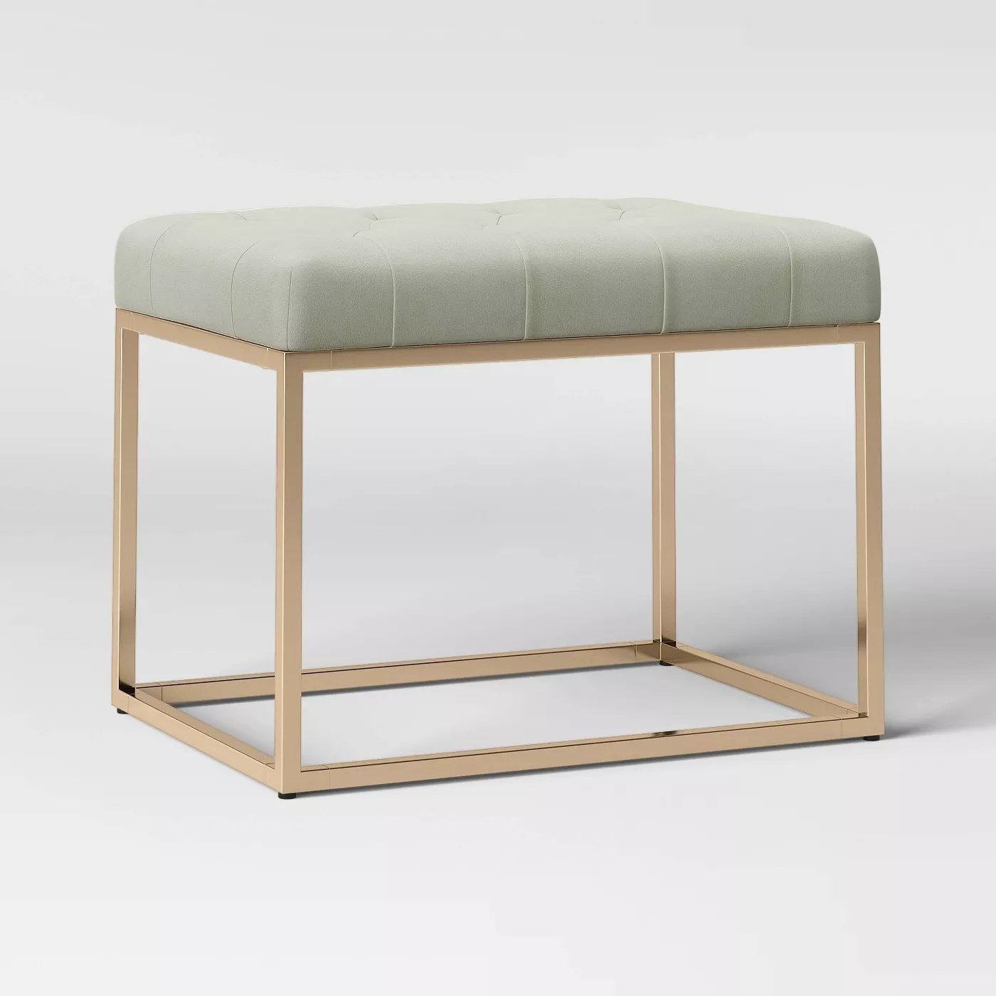 The leather ottoman bench with gold legs