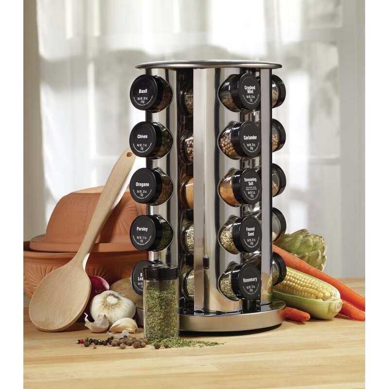The spice rack displayed on a counter to show the space it uses and the amount of spices it can hold