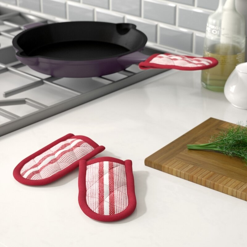 The red pan holders on the handle of a cast iron skillet