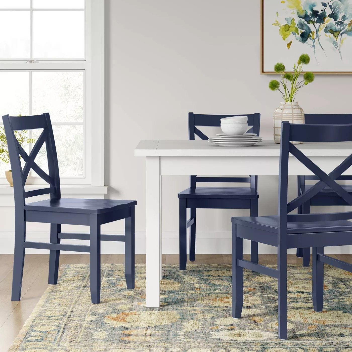 The blue dining chairs
