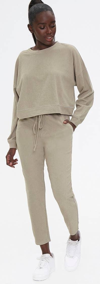 Model wearing sage colored jogger set