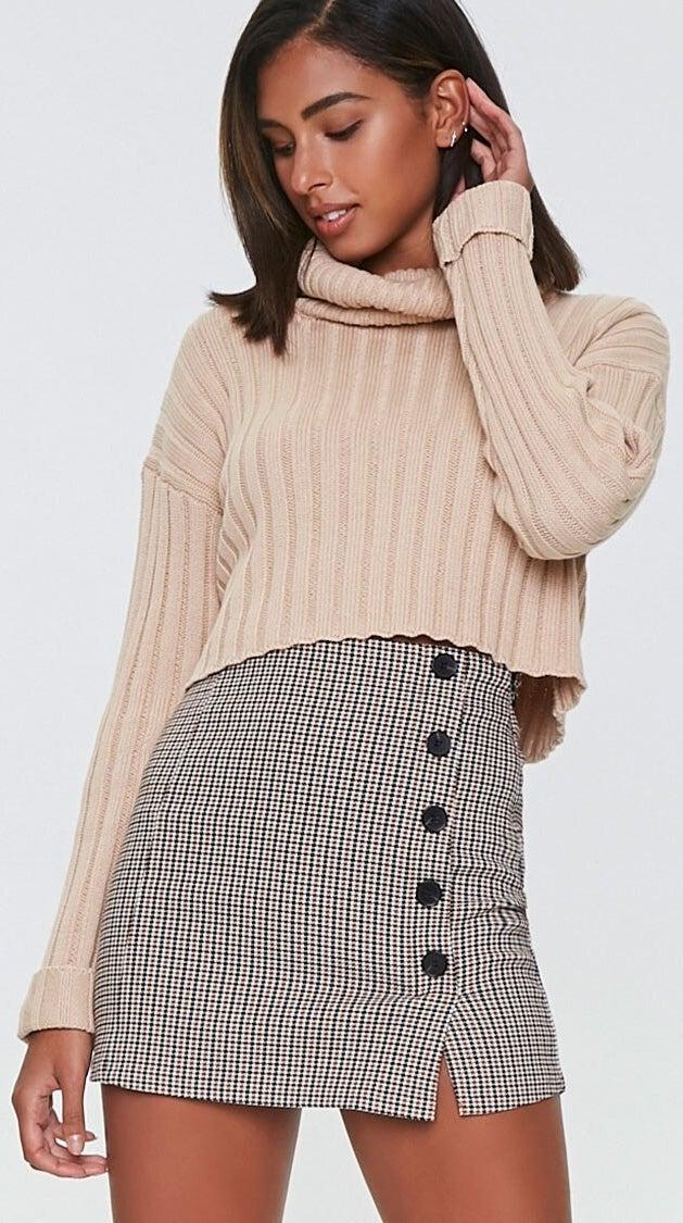 Model wearing plaid mini-skirt