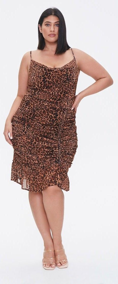 Model wearing leopard print dress