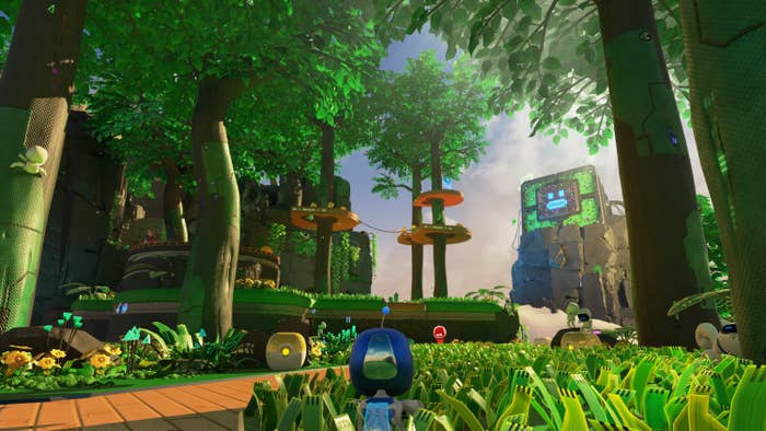 Astro's Playroom gameplay showing a small robot green grass and obstacles