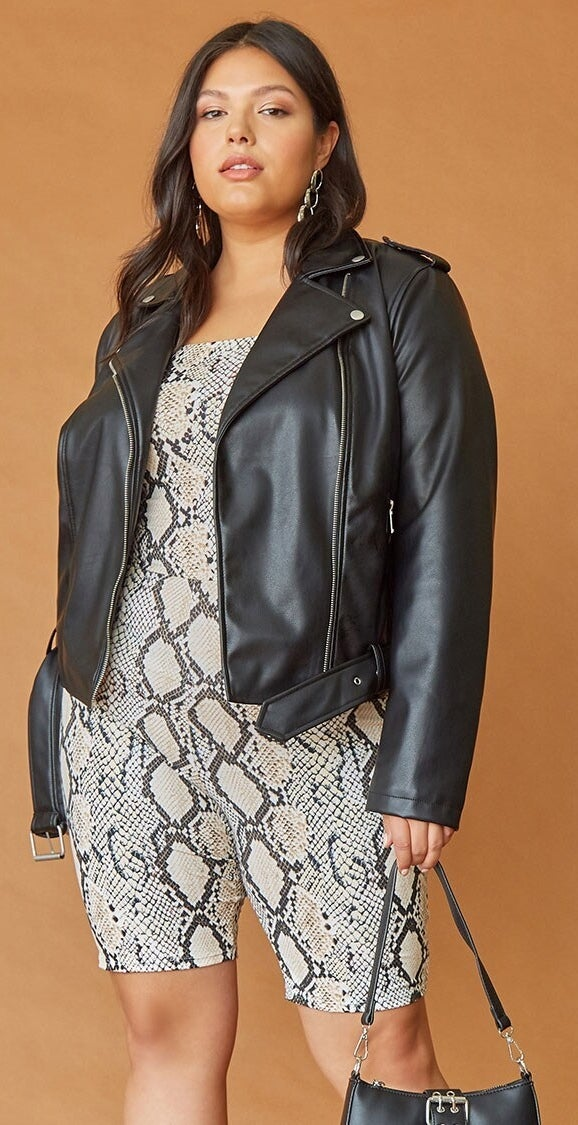 Model wearing black motorcycle jacket