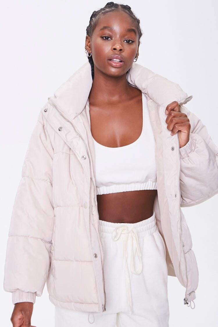 Model wearing cream puffer jacket