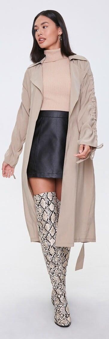 Model wearing long beige jacket