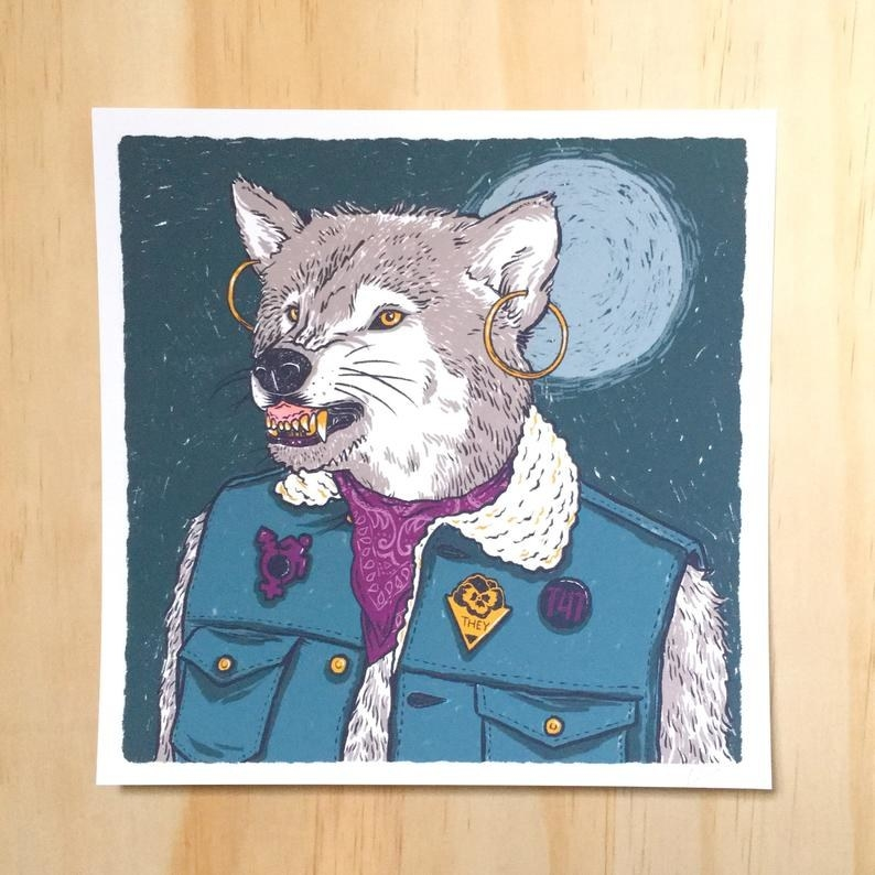 a print of a trans* werewolf wearing earrings, a they/them pin, a t4t pin, and a disabled trans* pride pin
