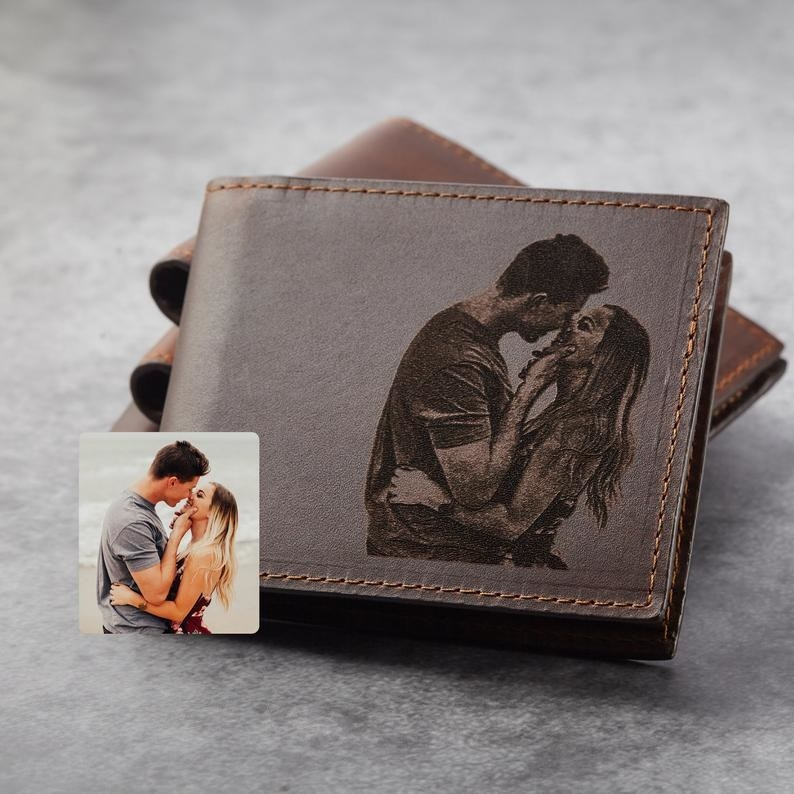 a leather wallet with a photo of a couple engraved on it