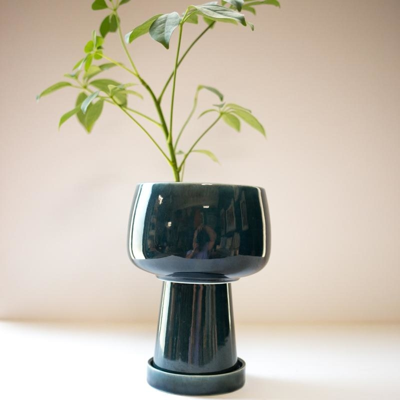 dark teal three-piece planter with a saucer, a narrower stem, and a pot on top