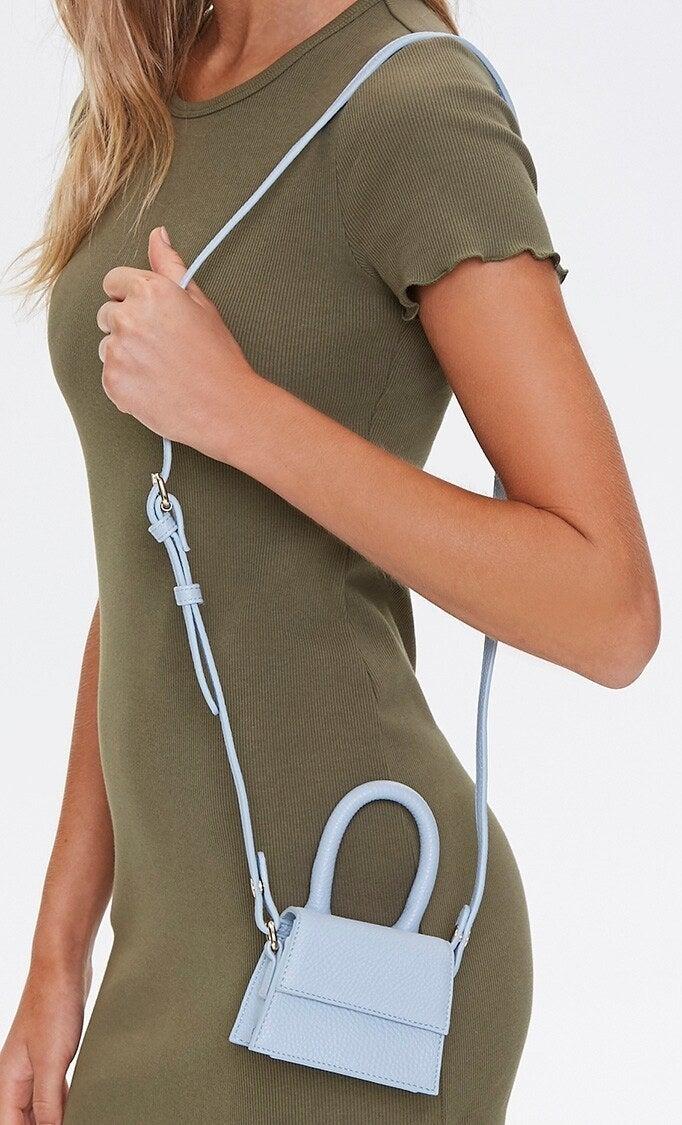 Model wearing pastel blue cross body mini bag