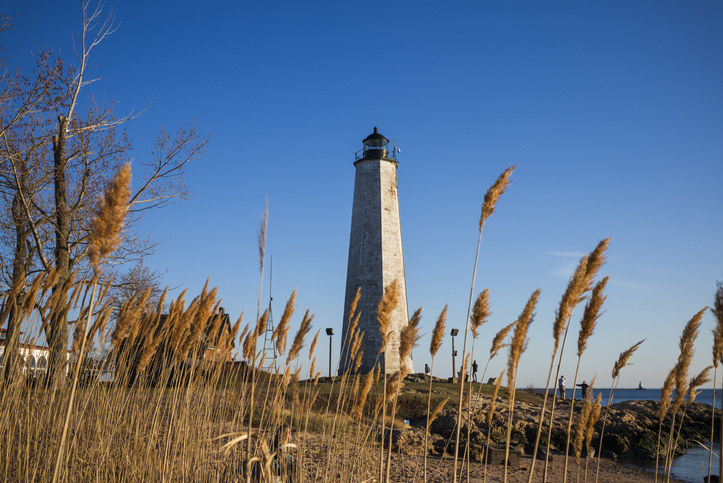 A lighthouse in New Haven against a blue sky