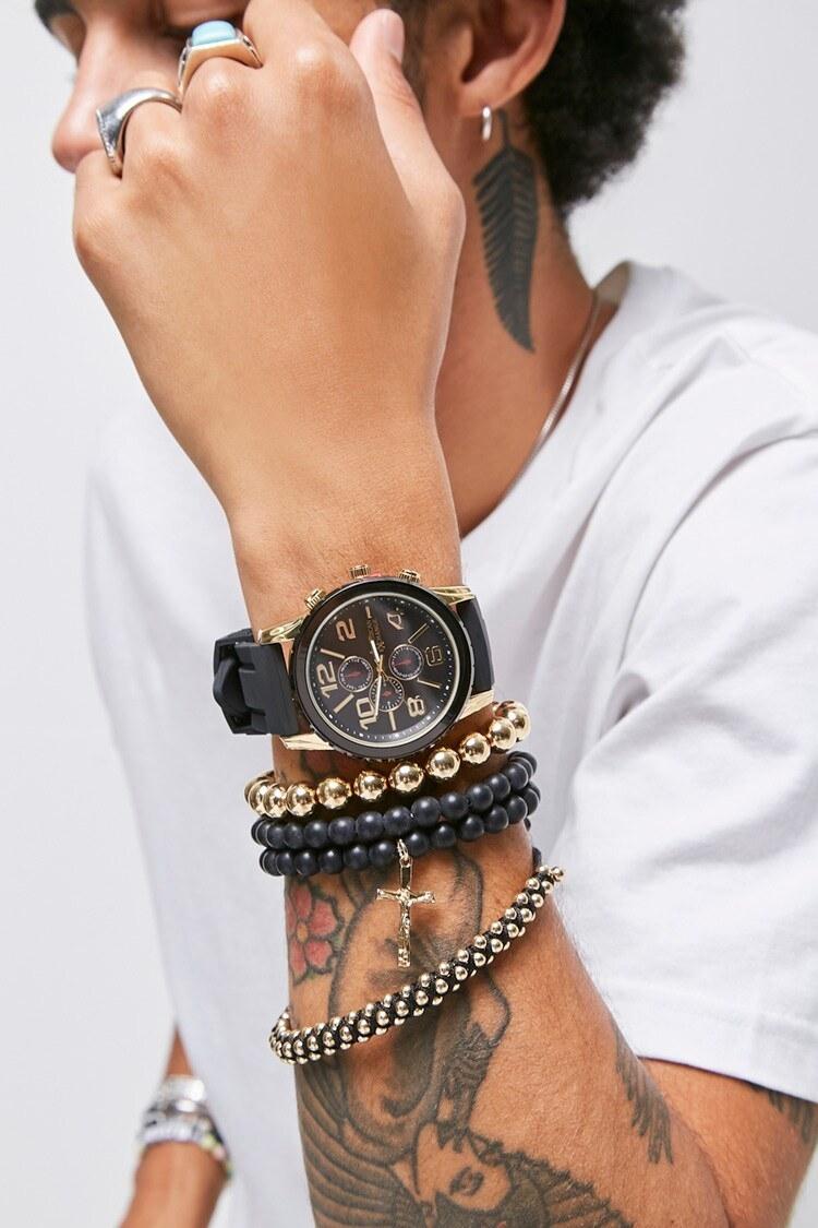 Model wearing watch and bracelets