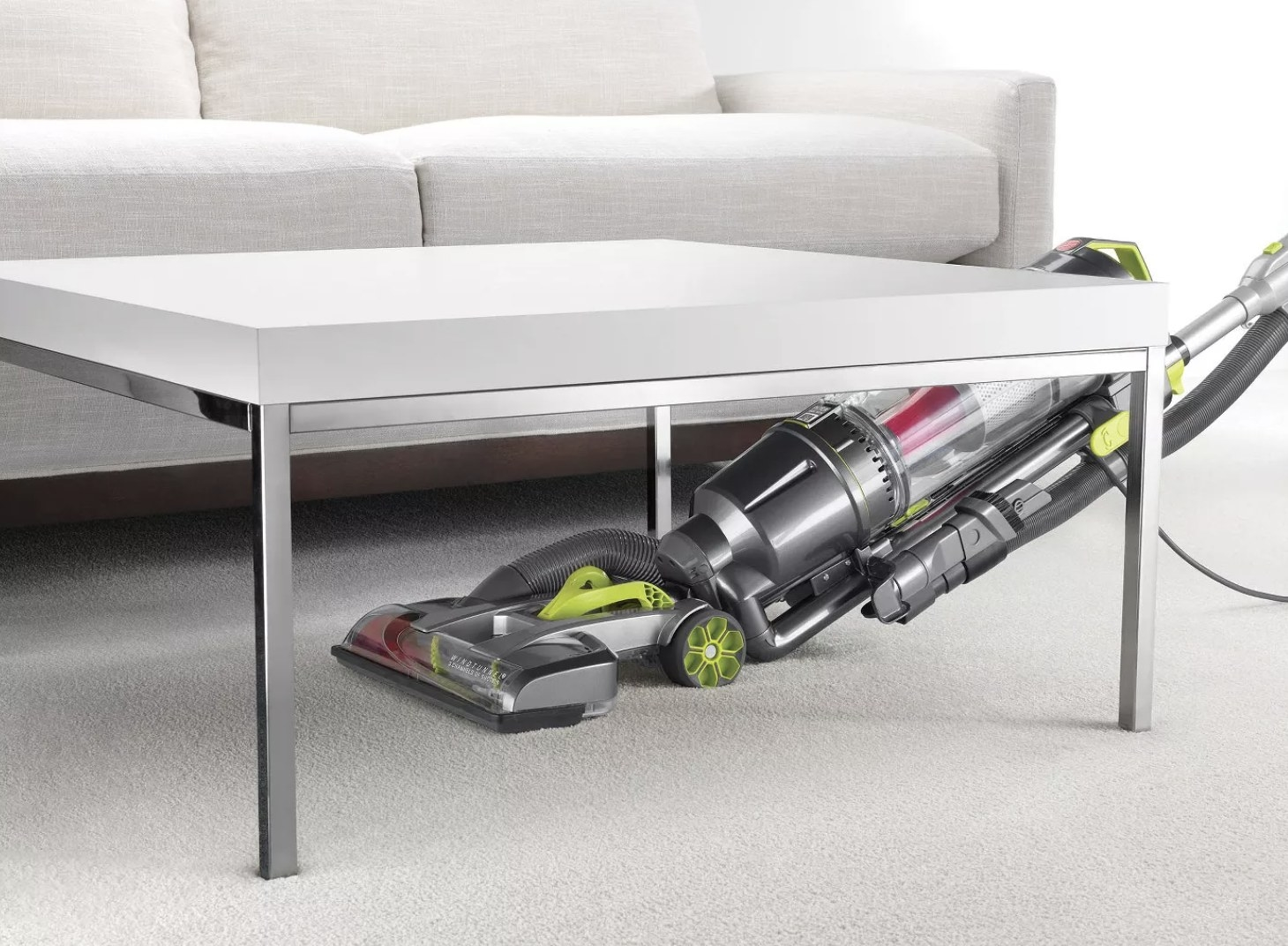 The vacuum under a coffee table vacuuming