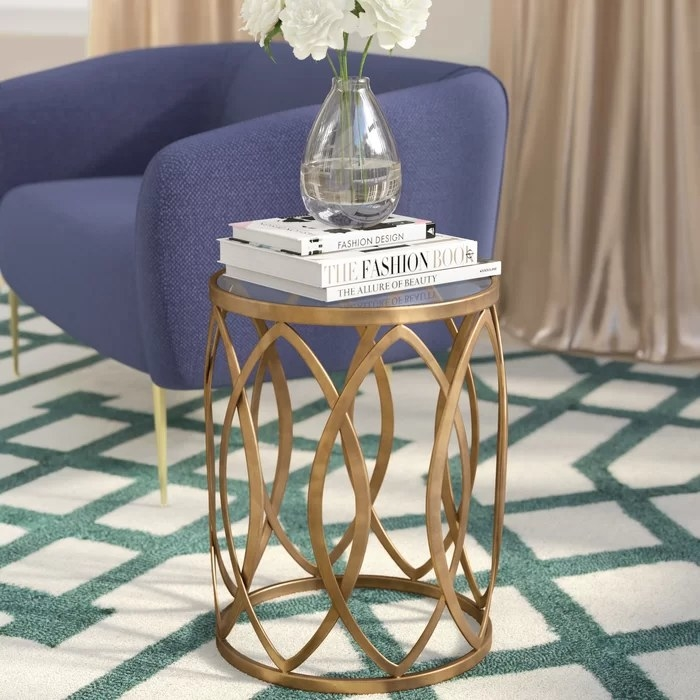 The table with books and filled flower vase on top