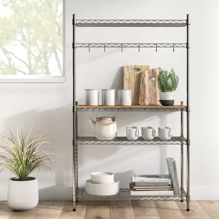 The baking rack containing kitchenware and cookbooks