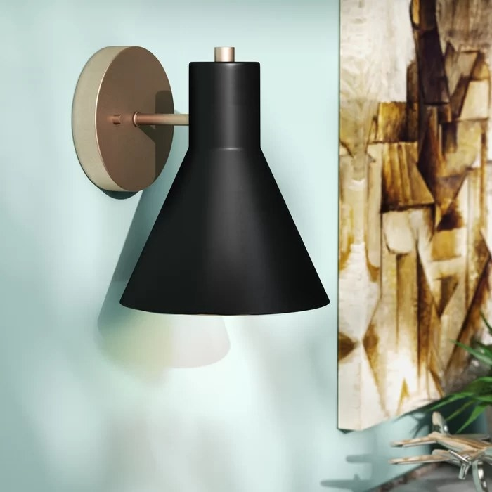 The light sconce secured to a wall