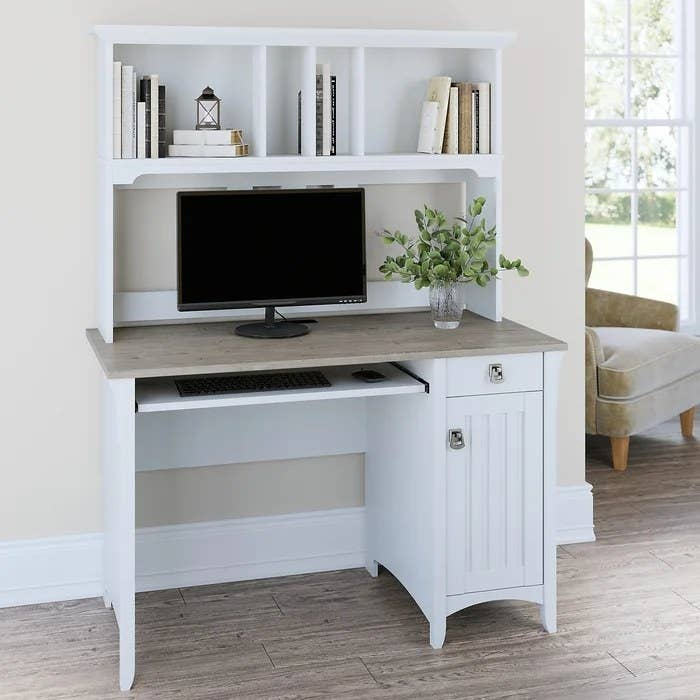 A white desk pushed against the wall