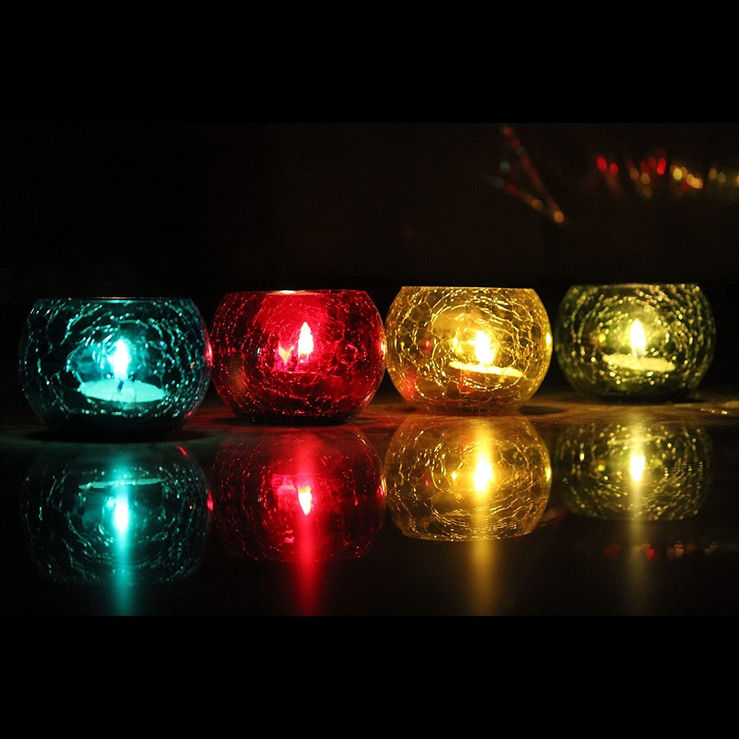 Crackled glass candle holders in blue, red, yellow, and green.