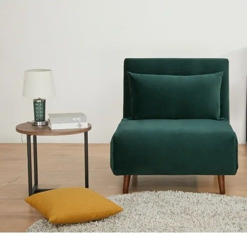 A green chair placed next to an end table