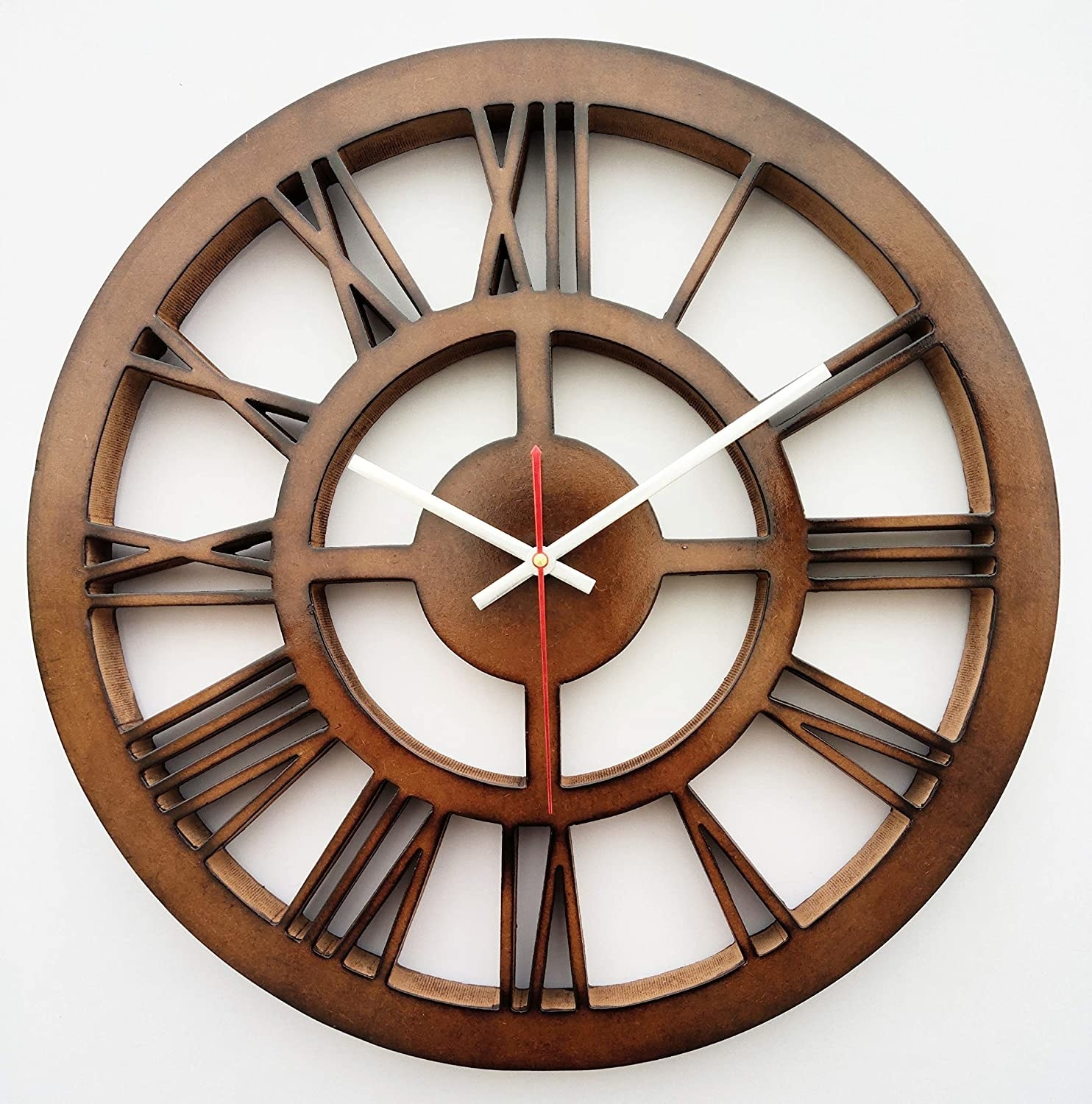 A brown MDF wall clock with Roman numerals.