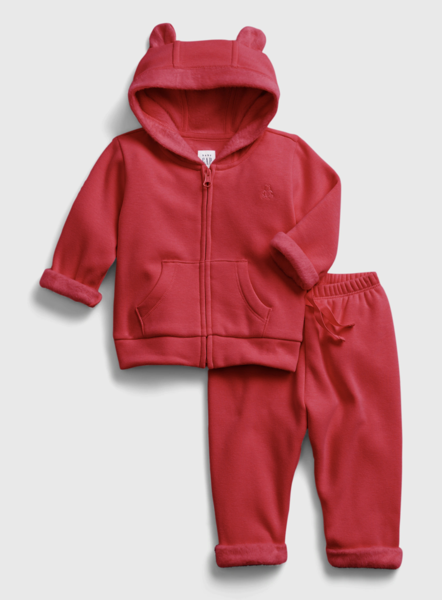 Product shot of baby sweatshirt and sweatpants in the shade modern red