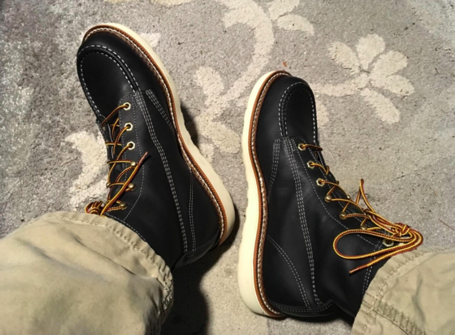 reviewer wearing the Thorogood boots in black
