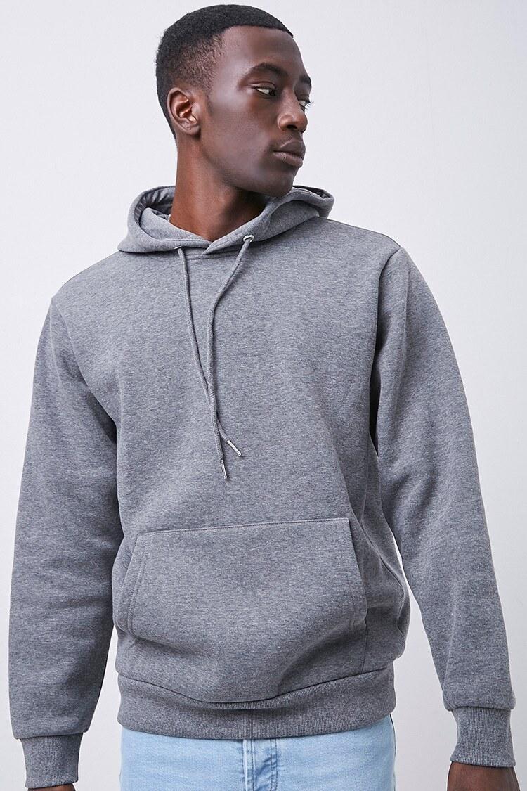 Model wearing charcoal hooded sweater