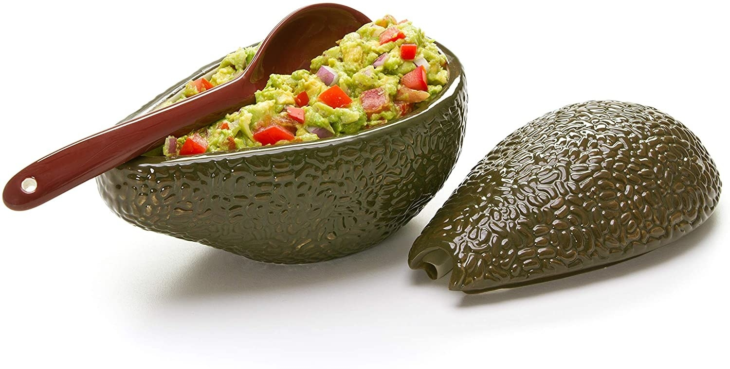 avocado shape bowl with guacamole in it