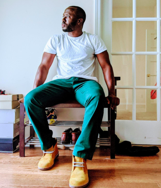 reviewer wearing Amazon essential chinos in pine green