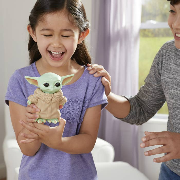 The toy, which looks like Baby Yoda, and which emits sounds to guide the game play