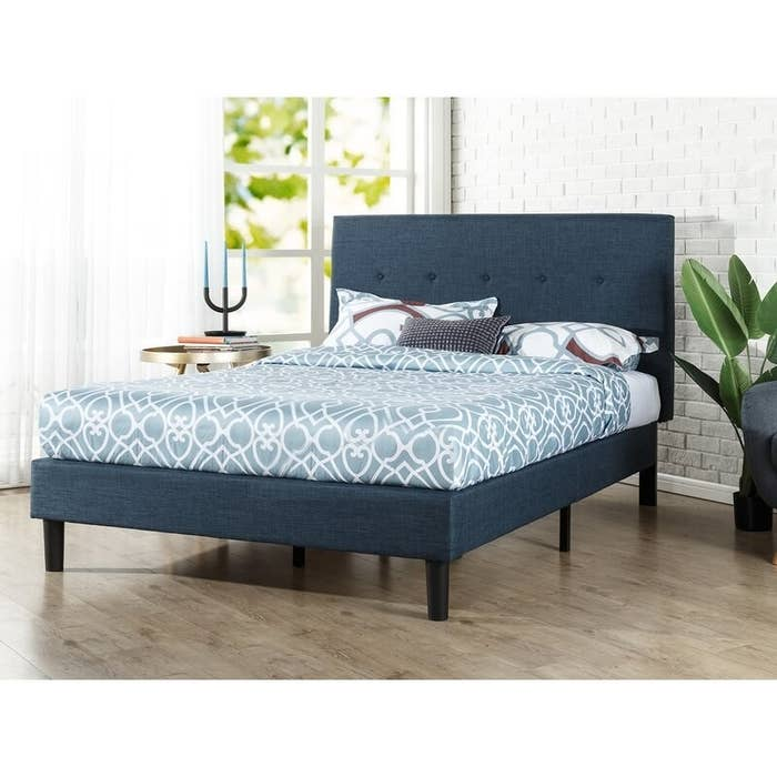 The navy platform bed in use