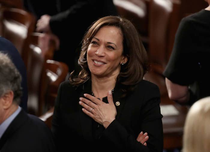 Kamala Harris smiling with her hand over her heart