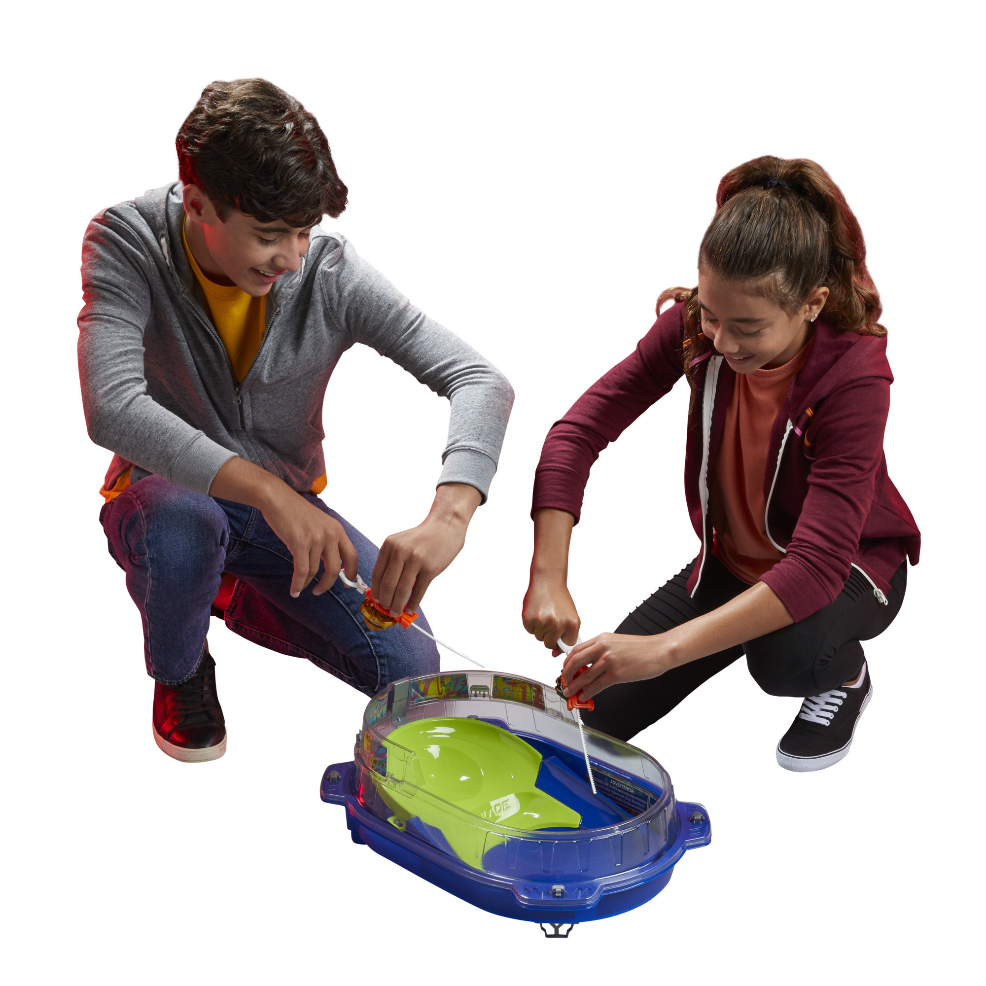 The Beyblade battle set, which is a small plastic arena with raised clear plastic guards around the edges