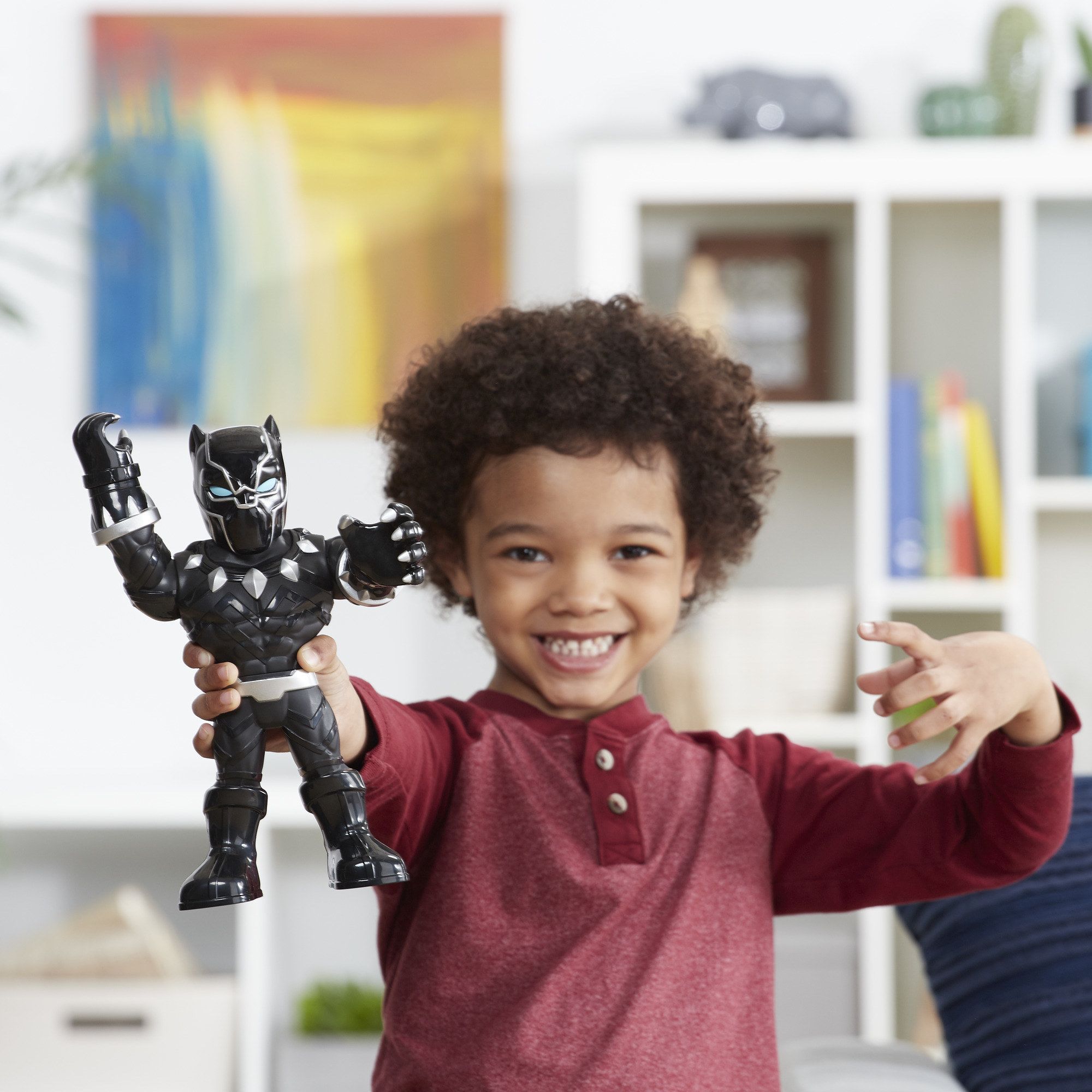 The Black Panther action figure, which is small enough for a young child to hold and has no small pieces