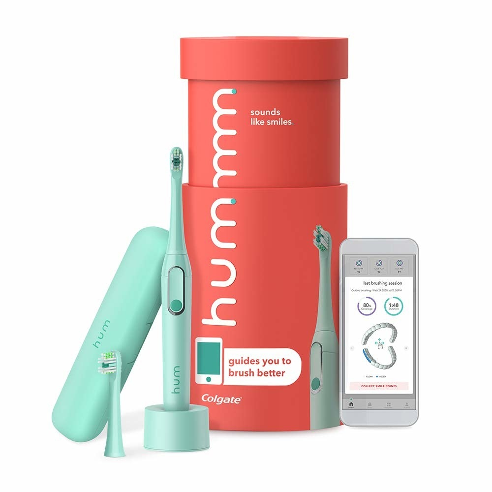 the mint colored toothbrush, replacement head, and travel case