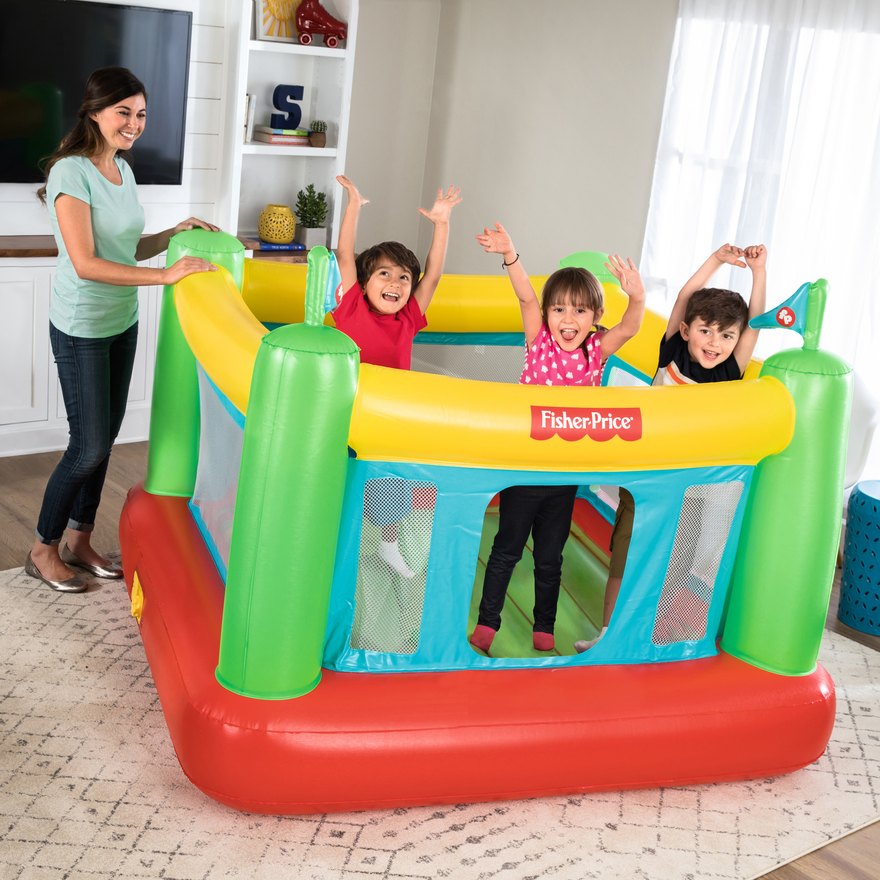The bounce house, which has one small entry area, mesh sides, and is about the height of the child's shoulder once they are inside