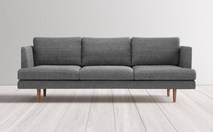 Gray modern couch with straight wooden legs