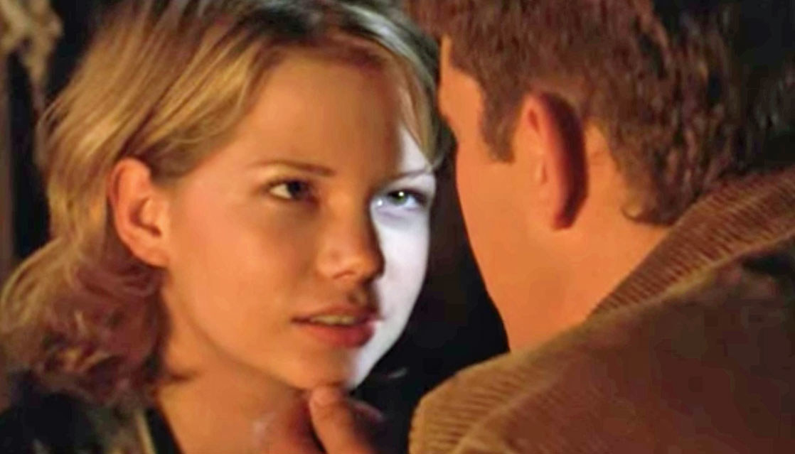 Jen looks at Pacey; Pacey's hand caresses Jen's chin