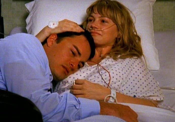Jen lies in a hospital bed, hugging a crying Jack to her chest