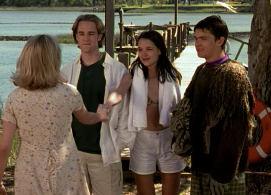 Jen shakes hands with Joey as Dawson and Pacey look on; they stand in front of the creek