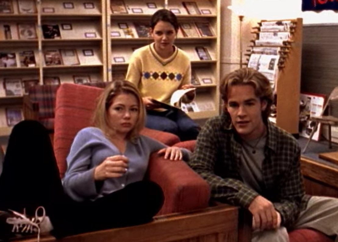 Jen, Dawson and Joey sit on couches in the school library