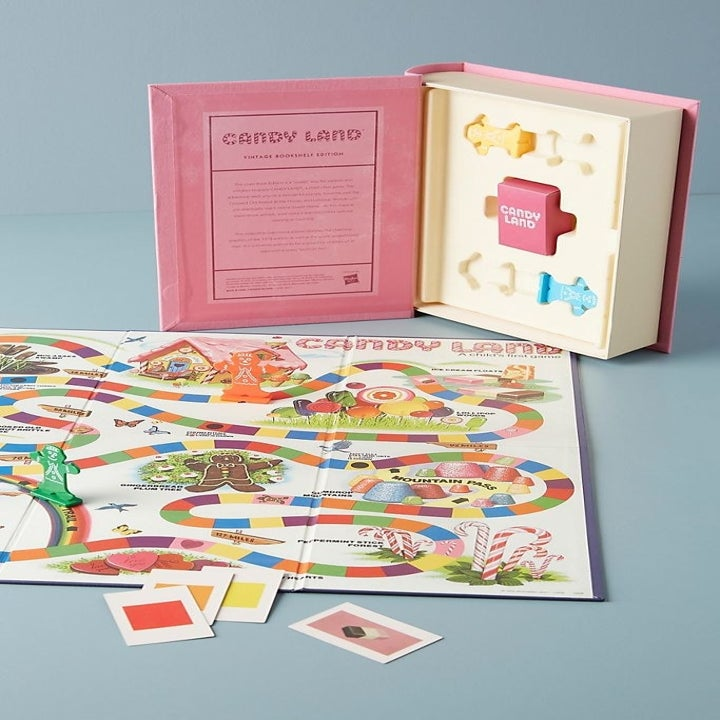 a compact candyland that fits inside a fake pink book