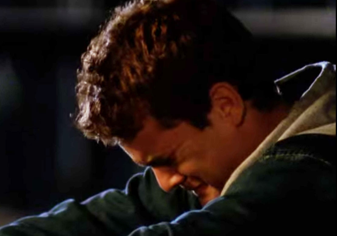 Pacey cries with his head bent down