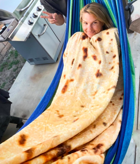 a reviewer using the blanket in a hammock