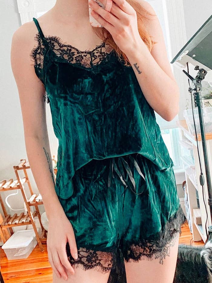 A reviewer in the green velvet tank and shorts set with black lace