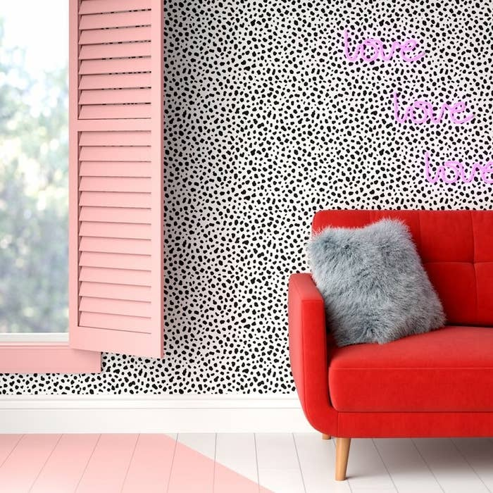 A white and black spotted wallpaper in a bedroom
