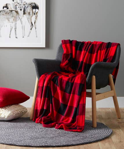 A large fluffy blanket draped over a small armchair