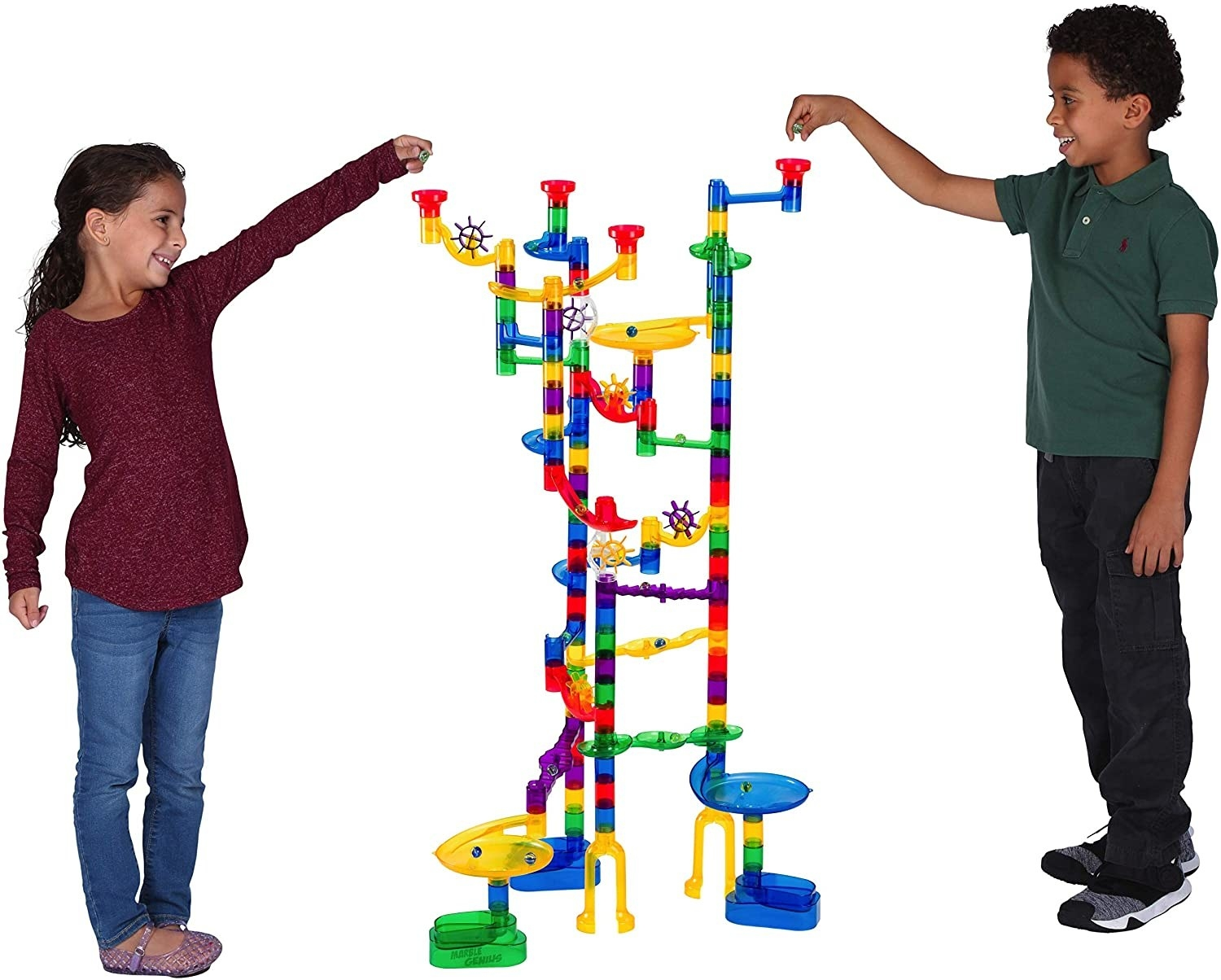 Two kids get ready to race marbles on the marble run set they built.